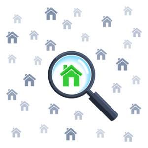 Lupe zeigt ein Haus Immobiliensuche